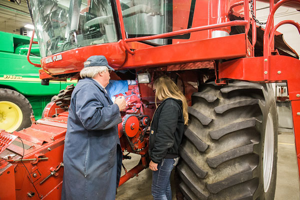 Student working on a combine at UNOH